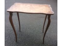 Pretty coffee, side older style wooden table