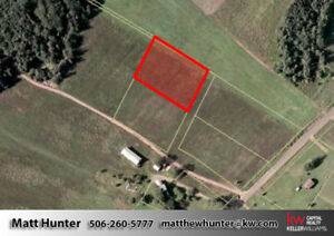 1 Acre Level Building Lot With View of Grand Lake!