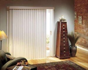 White vertical blinds with valence for patio door