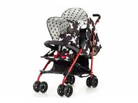 cosatto shuffle tandem buggy with star print design