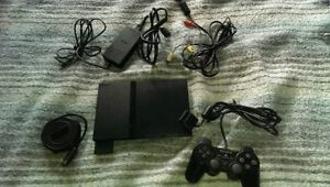 Sony Playstation 2 slim console with remote, memory card, stuff