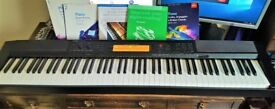 CASIO CDP 200R Digital Piano with Sustain pedal and song books.