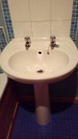 White ceramic bathroom sink and pedestal