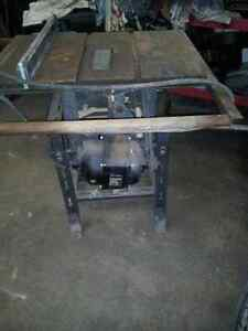 older heavy duty industrial table saw(atlas) with stand