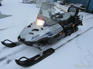 2 Arctic Cat Bearcat snowmobiles with  2 axle trailer package