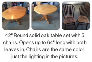 Solid Oak dining table and chairs set