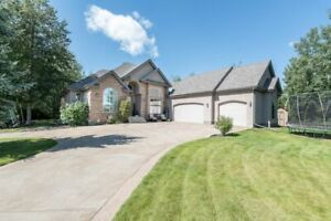GORGEOUS Bungalow Backing Northern Bear Golf Course!