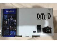 Olympus OM-D EM-5 plus lens and grip