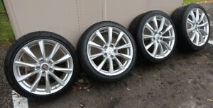 Infiniti 10 spoke Alloy 18 inch wheels & Continental Snow Tires