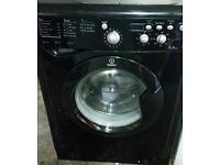 Black Indesit washing machine 7kg