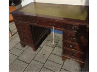 8 drawer old leather top desk