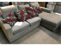 Grey corner sofa and contrasting scatter cushions