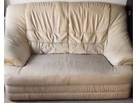 Two Seater Leather Sofa. Condition: Used with some mild wear and tear but functional and Comfortable
