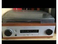 Vinyl record player with radio/speakers
