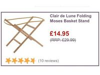 Brand new Clare de lune Moses basket and stand in white.