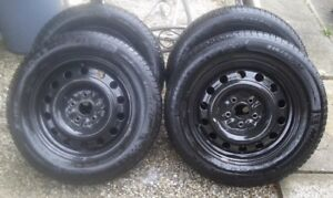 Barely Used Winter Tires/Rims $750