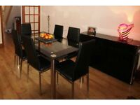 Glass Dining Table with six faux leather chairs