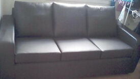 Three seater brown leather couch