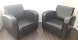 2 brown leather tub armchairs