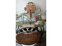 Beautuful bespoke glass and wrought iron table and 4 wicker, wrought iron cream upholstered chairs
