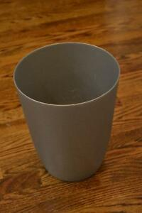 Small grey plastic garbage can