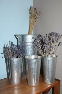 3 antiques milk shake containers and one modern lavender vase