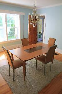Sleek and Contemporary Dining Table and Chairs