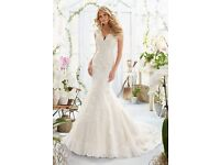 Wedding Dress with veil, brand new, never worn and still in packaging.