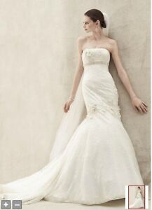 Ivory wedding dress and vail with beaded head comb