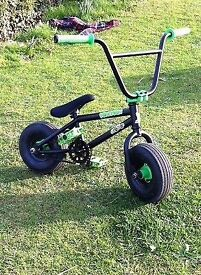 Reduced to sell - Mini rocker BMX bike black and green, exc cond, no longer used so kids selling it