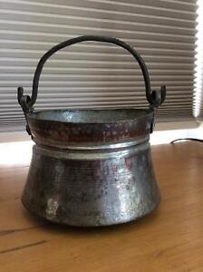Antique copper pot with wrought iron handles