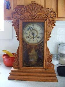 Antique gingerbread clock. (REDUCED) From $225.00 to $175.00.