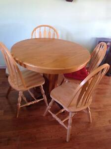 For sale.  Round oak table and  4 Chairs