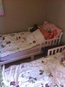 White like new toddler bed with mattress