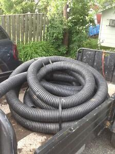 2 partial rolls of 4 inch perforated pipe