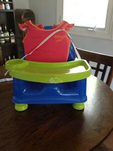 Child booster seat and girls swim suit