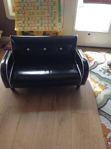 Black with white pipping leather look childrens couch