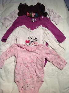 Four long sleeved onesies - size 9 mos