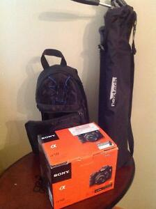 Sony a58 digital camera with lens, tripod and camera case