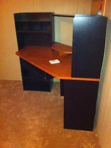 Corner computer desk, black and tan in color, $20
