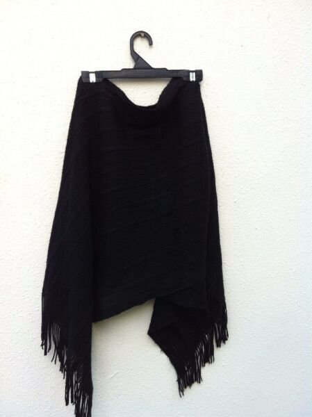 Black shawl. Wear over the head.  In good condition.