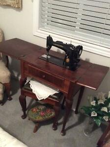 Antique Singer sewing machine in beautiful cabinet.