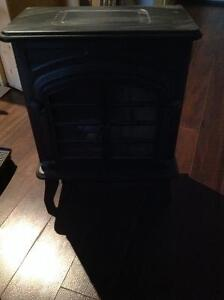 Electric heater with logs