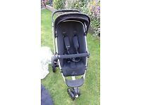 Quinn's buzz rocking black push chair for sale