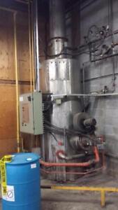 Chauffe eau usagé Sofame 3000000 btu au gaz naturel ,le tout inclus reservoir bruleur tuyauterie entourant cette install
