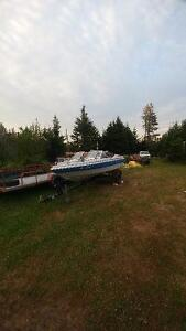 15 1/2 FOOT BOAT MOTOR AND TRAILER works great