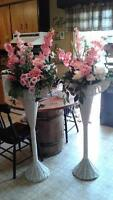 Two tall wicker flower displays