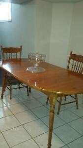 Solid table with extensions and 6 chairs