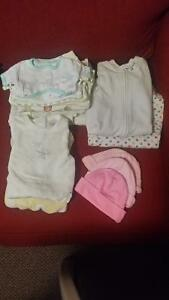 Newborn -3 month girl snow suits with beenies.