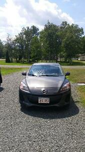 mazda 3 for sale . asking 13000 neg.